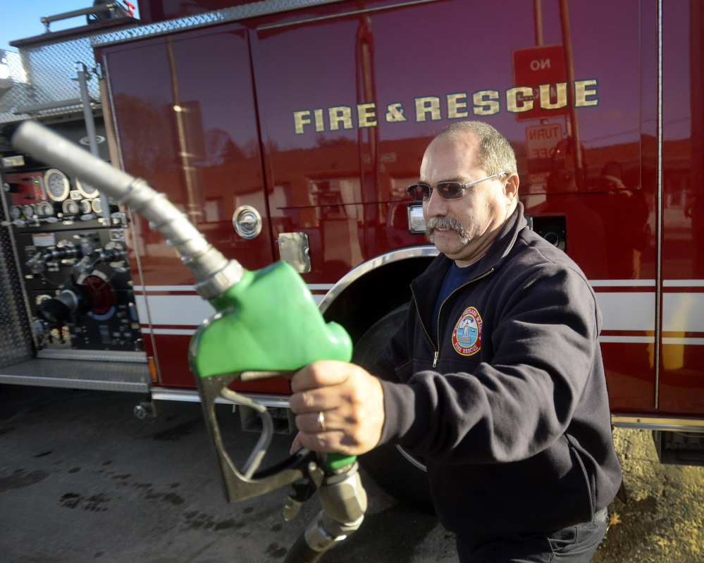 South Portland firefighter John Pallozzi finishes filling a vehicle with fuel Tuesday at the Public Works Department. The city uses about 135,000 gallons of fuel annually.