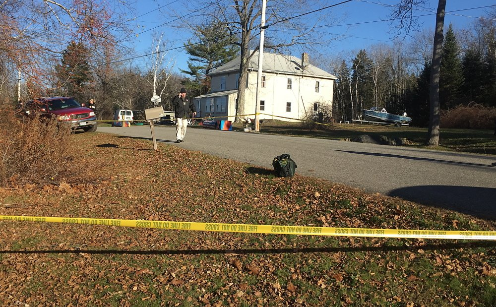 A Cumberland County Sheriff's Deputy talks on a phone near the home on Long Island were the body of a man was found early Wednesday morning. David Hench/Staff Writer