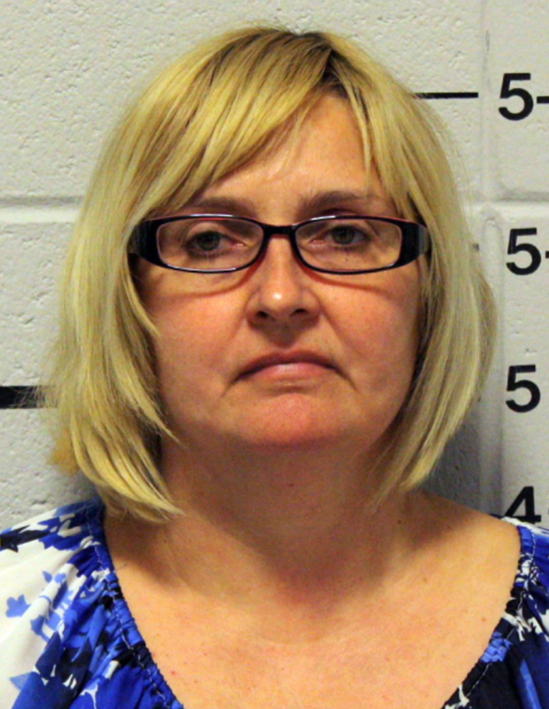 Genevieve Kelley was charged Monday with custodial interference for fleeing with her 8-year-old daughter a decade ago.