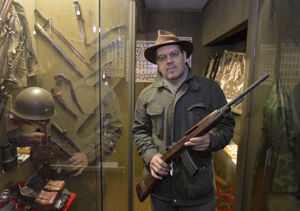 The Korean War-era M1 carbine held by Lynden Pioneer Museum director Troy Loginbill may seem an artifact, but since it's post-1898, it's affected by a new law.