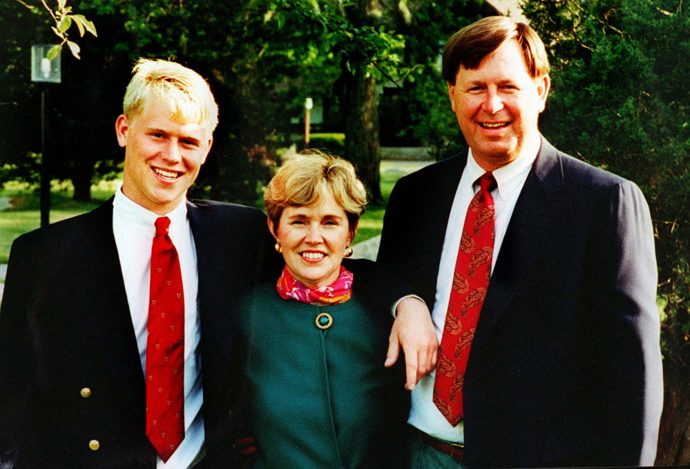Travis Roy poses with his mother, Brenda, and father, Lee, for a photo in 1995, the year the young hockey player had the accident that left him paralyzed.