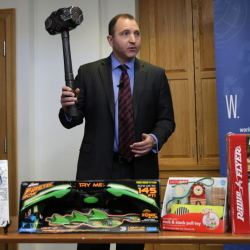 James Swartz, director of World Against Toys Causing Harm, holds up a toy battle hammer at the Children's Franciscan Hospital in Boston on Wednesday.