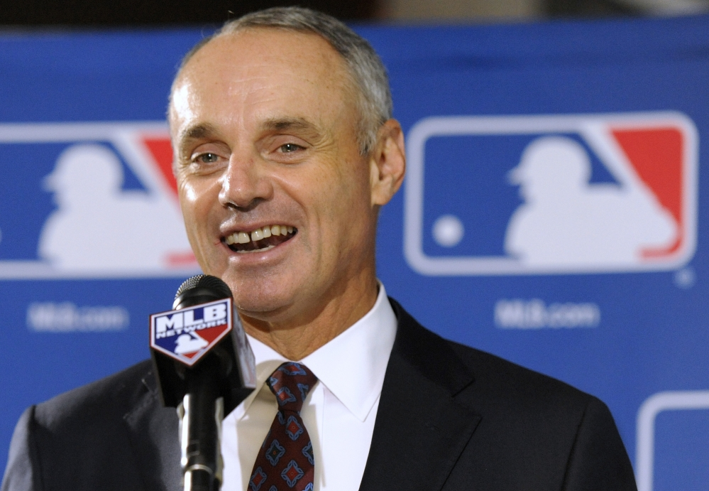 Major League Baseball Chief Operating Officer Rob Manfred will become commissioner in January, with a five-year term that team owners approved Thursday.