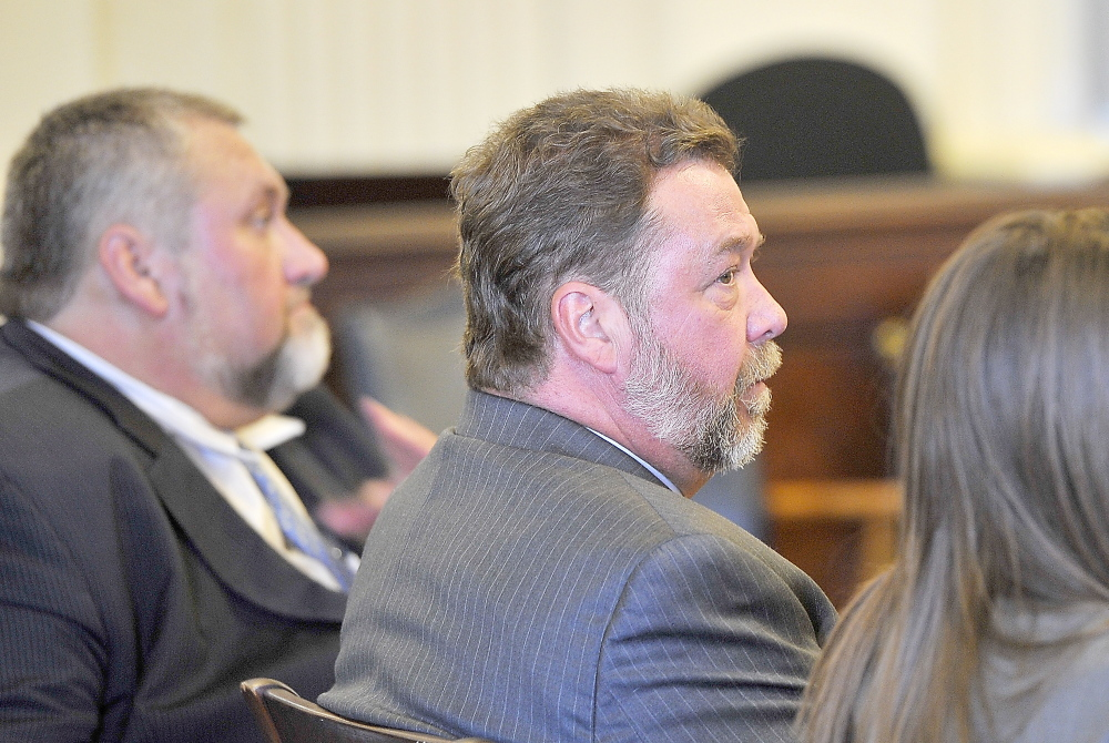 ALFRED, ME - NOVEMBER 21: Ronald Petersen, sitting between his counsel, looks to the jury as they begin to announce their guilty verdict at his trial for fraudulent billing in York County Superior Court - Alfred. (Photo by Gordon Chibroski/Staff Photographer)