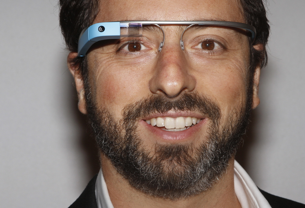 Google founder Sergey Brin poses for a portrait wearing Google Glass glasses.