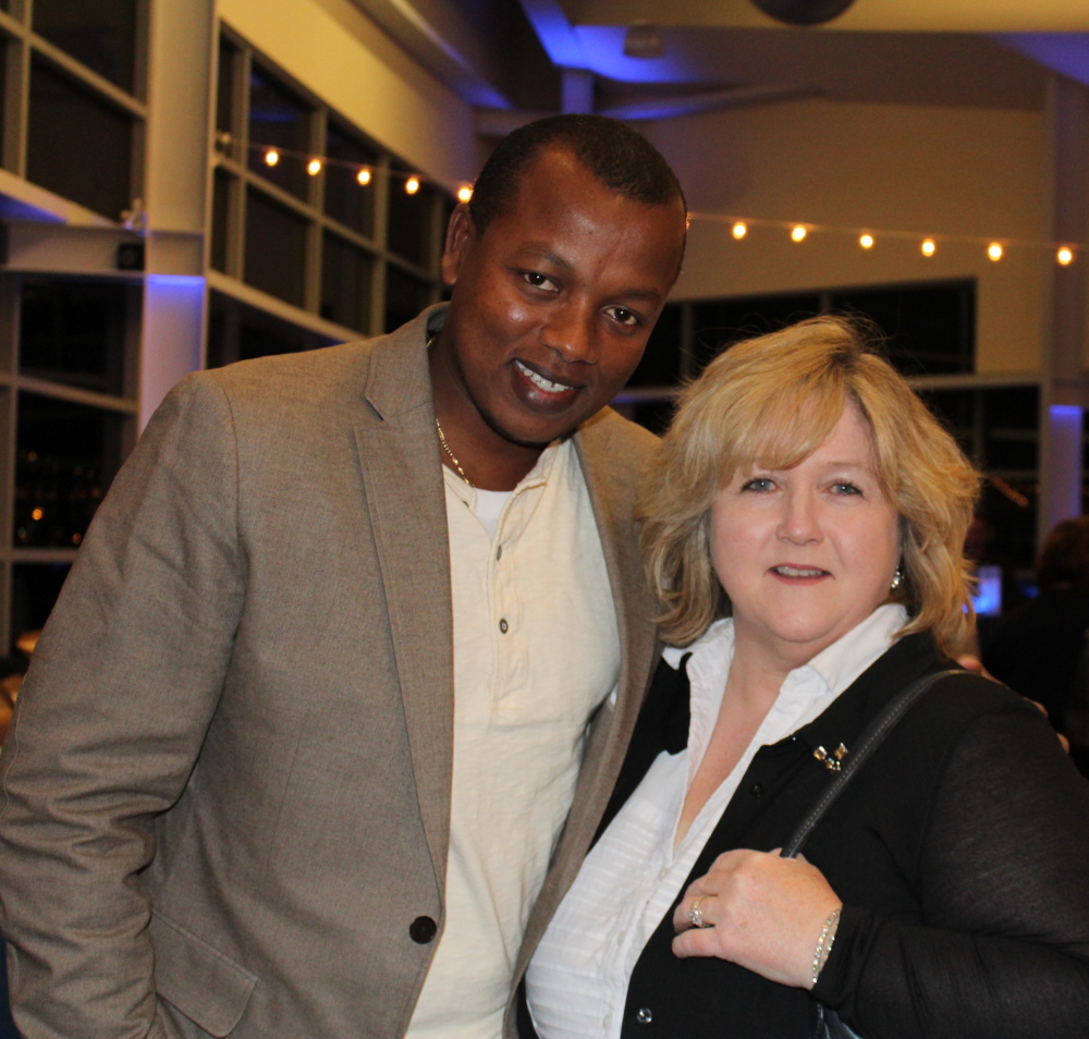 Arsene Sebaziga of the Maine Department of Transportation with Kathy Kern, a member of Engineers Without Borders.
