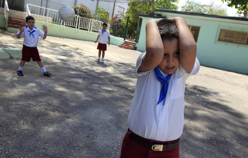 An autistic child plays with fellow students at the Dora Alonso School in Havana in 2013. Advocates for people with autism hope that the Vatican's first conference on the disorder will help raise awareness of it, particularly in Spanish-speaking countries.