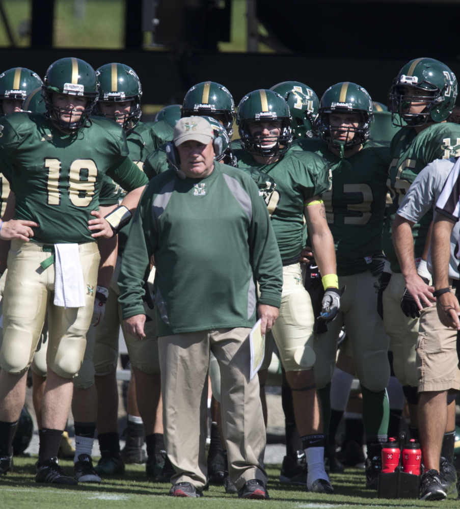 Gabby Price, who started the football program at Husson University, is back. After a down period, the team is in the NCAA Division III playoffs for the first time.
