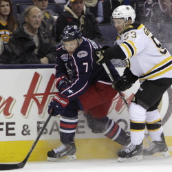The Columbus Blue Jackets' Jack Johnson tries to carry the puck past Boston's Seth Griffith during the first period of Friday night's game in Columbus, Ohio.