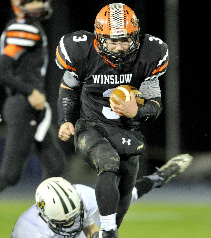 Dylan Hapworth of Winslow heads down the field, and he was doing plenty of that Friday night. Hapsworth scored seven touchdowns and gained 236 yards in a 62-14 victory against Leavitt in the Class C state final at Orono.