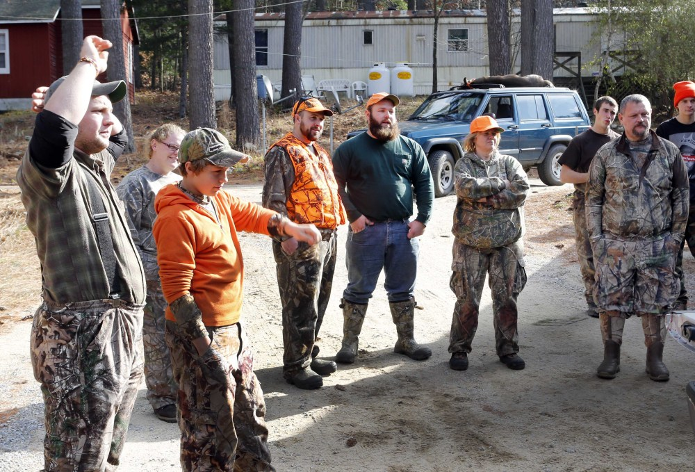 Hunters gather at the deer check station in Hillsboro, N.H. State officials hope local food connoisseurs will grow the number of licensed hunters.