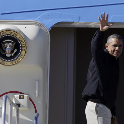 President Barack Obama waves as he boards Air Force One at McCarran International Airport, Sunday, in Las Vegas.