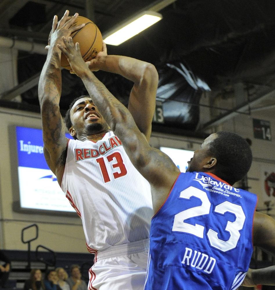 Maine's James Young gets off a short jumper over Delaware's Victor Rudd during Sunday's 120-102 victory at the Expo.