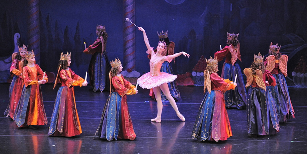 """The Sugar Plum Fairy is surrounded by Angels who watch over the Land of the Sweets in Maine State Ballet's """"The Nutcracker."""" """"Wouldn't want anyone smuggling in vegetables,"""" director Linda MacArthur Miele jokes."""