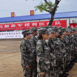 Chinese soldiers stand outside the new Ebola virus treatment center sponsored by China in Monrovia, Liberia, on Tuesday. The 100-bed clinic will begin taking patients next week.