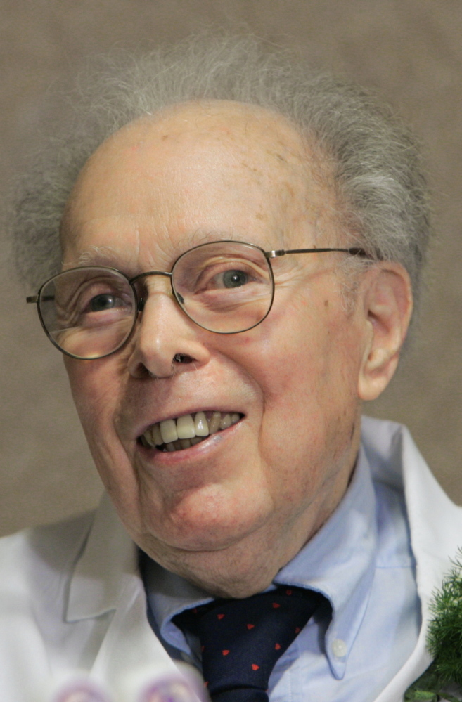 Dr. Denham Harman, shown at his 90th birthday celebration, died Tuesday at age 98.