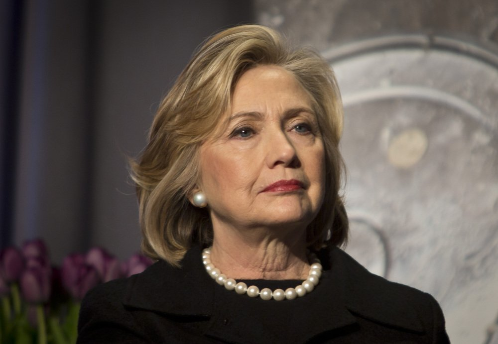Hillary Clinton listens before delivering remarks at an event Friday in New York. Clinton has praises President Obama's executive actions to stave off deportation for millions of immigrants living in the U.S. illegally, but has been less forthcoming on other issues in the early days of the 2016 presidential campaign.