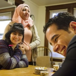 Ali Farid, right, served the U.S. and now gets to enjoy its freedoms along with his 15-year-old sister Mariam, center, and mother Dunya Al Obaidi, who will add some of their native land's cuisine to the Thanksgiving feast.