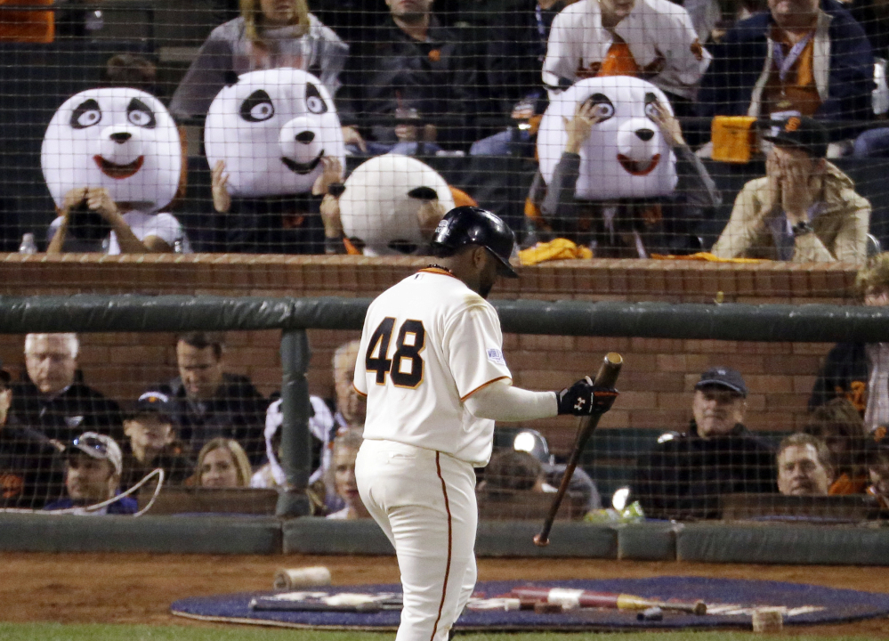 Pablo Sandoval walks past fans wearing panda heads during Game 4 of this year's World Series at AT&T Park in San Francisco. With Sandoval's departure to the Boston Red Sox this week, Giants fan Sam Li says he and his friends have decided to find a new way to honor their home team.