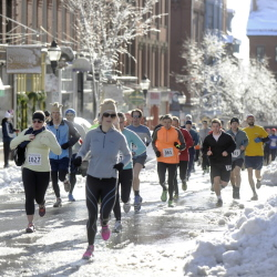 Runners make their way up Exchange Street in Portland during the annual Thanksgiving Day 4-mile road race.