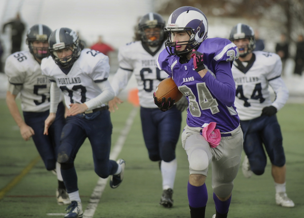 Jacob Coon of Deering finds room to run Thursday following a dropped punt in the Thanksgiving Day game with Portland at Fitzpatrick Stadium. The Rams avoided a shutout with a returned fumble by Keegan Meas-Stanton in the final minute.