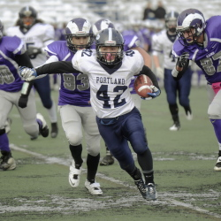 Now this was a common enough sight on Thanksgiving morning Thursday – George Chaison-Lapine of Portland heading down the field with the Deering defense in pursuit, Chaison-Lapine gained 134 yards rushing and also returned the second-half kickoff 65 yards.