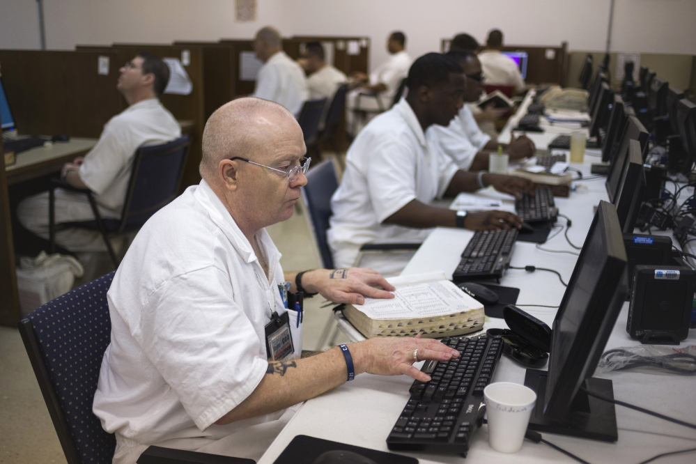 Inmates do academic work in a computer lab in a prison in Rosharon, Texas. Formerly known for being tough on crime, Texas now draws attention for reversing the explosive growth of its inmate population.