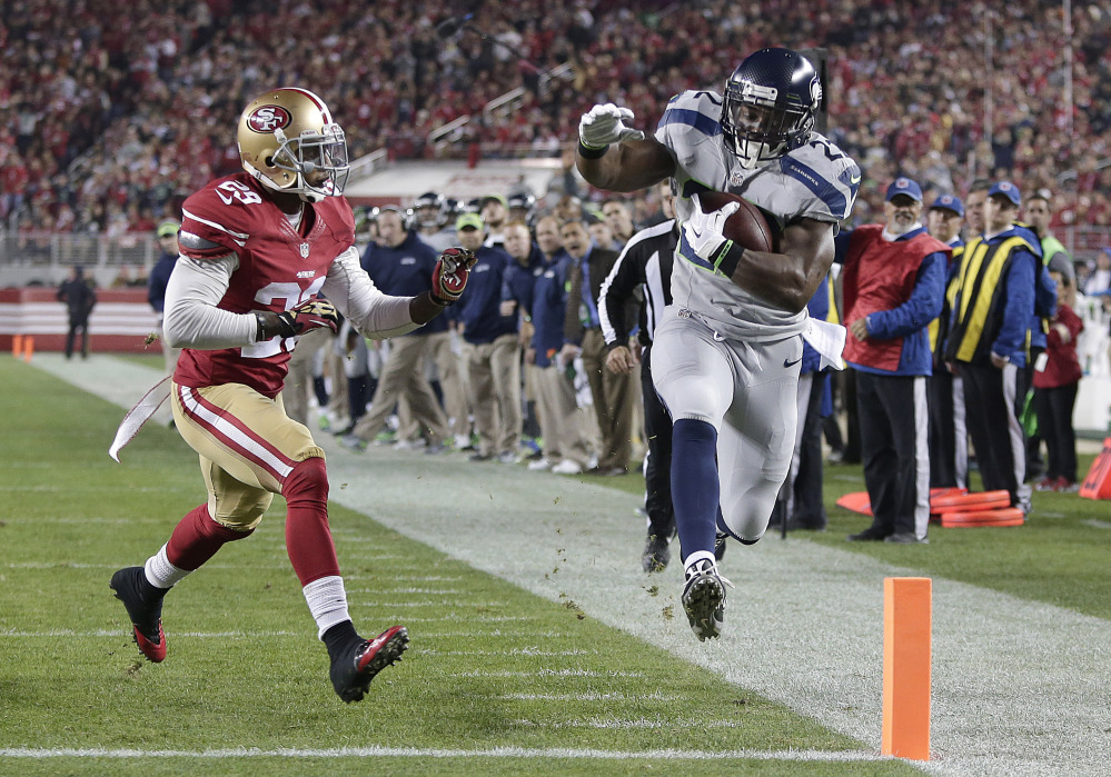 Seattle running back Robert Turbin scores on a 13-yard touchdown reception in front of San Francisco defensive back Chris Culliver Thursday in Santa Clara, Calif.