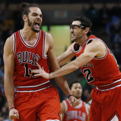 Chicago Bulls center Joakim Noah, left, celebrates with guard Kirk Hinrich (12) after making a crucial basket in the last minute of a basketball game against the Boston Celtics in Boston, Friday, Nov. 28, 2014. The Bulls won 109-102. (AP Photo/Elise Amendola)