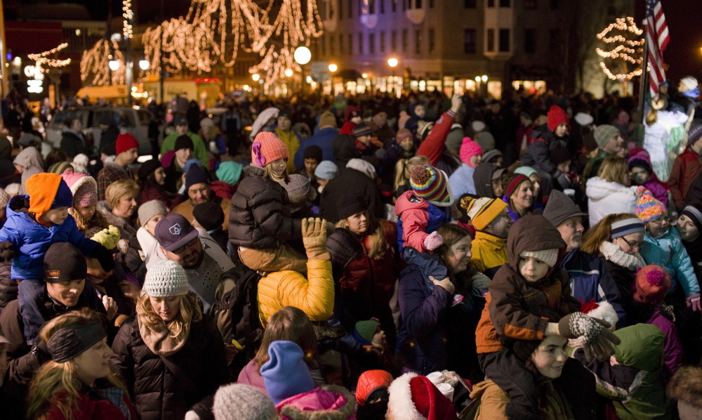 A crowd gathers for the Christmas tree lighting festivities in Portland's Monument Square on Friday.