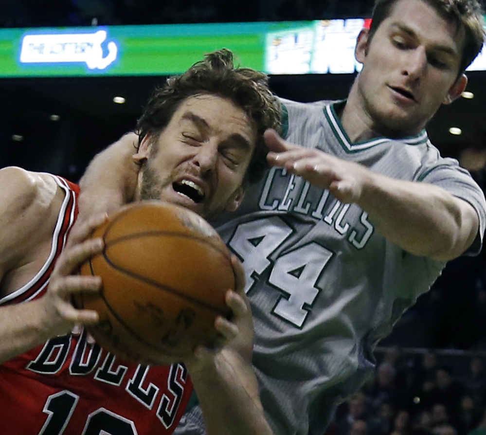 Boston Celtics center Tyler Zeller defends against Chicago Bulls forward Pau Gasol in the first half of Friday's game in Boston, won by the Bulls.
