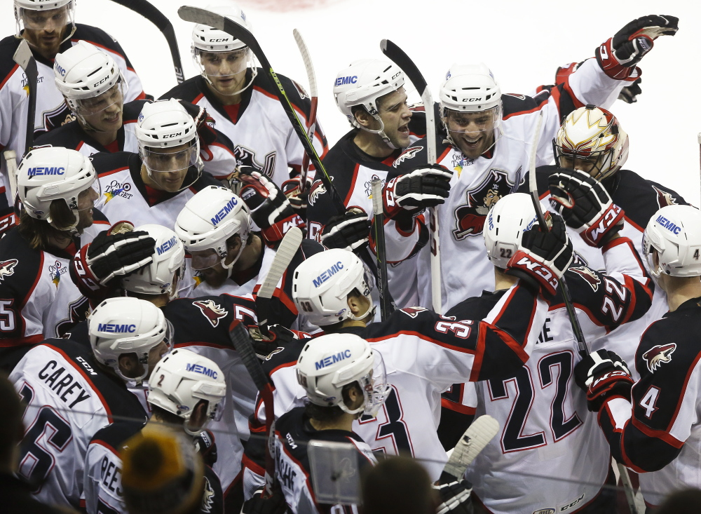 Game over, victory assured and the Portland Pirates are a happy bunch Friday night following the 3-2 overtime victory against the Providence Bruins at the Cross Insurance Arena.