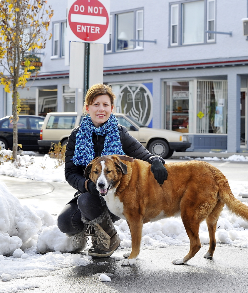 Melanie Wiker, a resident of South Portland's Knightville neighborhood, seen with her dog, Hamilton, wants city officials to reopen a one-way section of Ocean Street to two-way traffic.