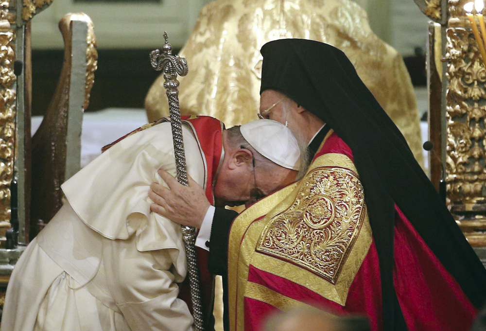 Pope Francis, left, bows to Ecumenical Patriarch Bartholomew I during an ecumenical prayer at the Patriarchal Church of St. George in Istanbul on Saturday. The two major branches of Christianity represented by Bartholomew and Francis split in 1054 over differences on the power of the papacy. The two spiritual heads participated in an ecumenical liturgy and signed a joint declaration in the ongoing attempt to reunite the churches.