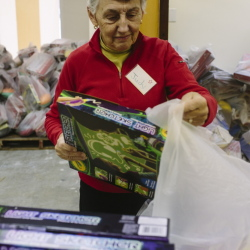 """Judy Oliver packs toys for the Portland Press Herald Toy Fund in Freeport on Friday. """"When you think of little kids getting these toys, it's terrific. Most people are very grateful,"""" she said."""