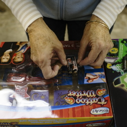 Jody Abbott tapes batteries to toys in Freeport.