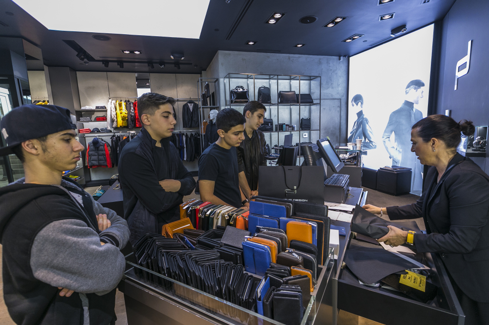 Youngsters from left, Gurgen Benyaminyan, 15, Zor Begoyan, 14, Gor Begoyan, 14, and Eduard Kyureghyan  14, shop at the Porsche Design store at the Glendale Galleria shopping mall in Glendale, Calif, Friday.