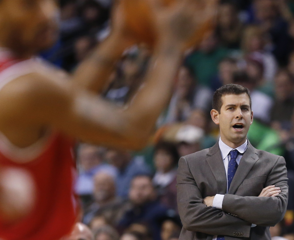 Celtics Coach Brad Stevens instructs from the bench during the first half of Friday's 109-102 loss to the Bulls in Boston. Despite a rough stretch, Stevens remains cool in public.