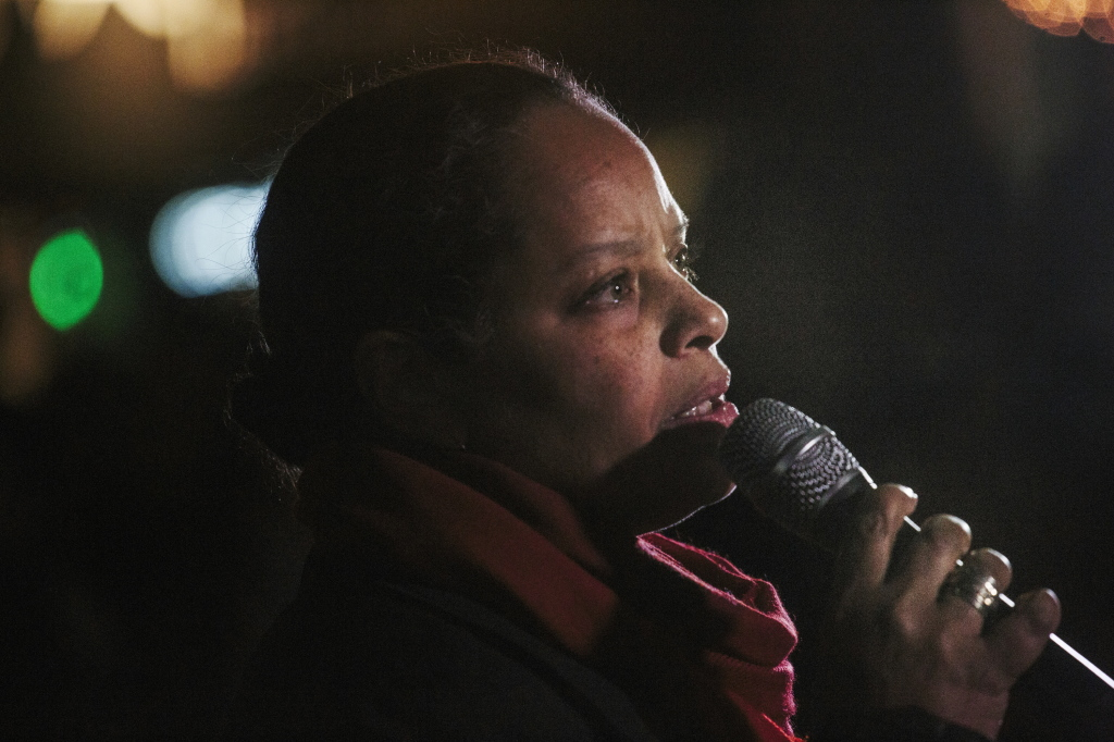 "Rachel Talbot Ross gives a reading of ""What Shall I Tell My Children Who Are Black,"" during a rally held Tuesday night in Portland's Monument Square in response to a Missouri grand jury's decision to not indict Officer Darren Wilson in the killing of Michael Brown in Ferguson."
