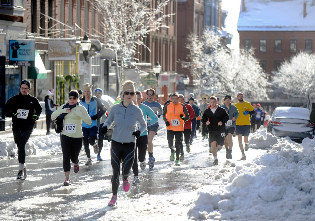 Runners make their way up Exchange Street in Portland during their 4-mile run Thursday morning.