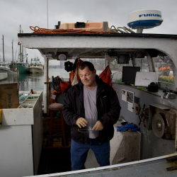 Chief Frederick Moore III of the Pleasant Point reservation is seen on his fishing boat in Eastport. Moore is part of the growing food sovereignty movement in the tribe.  Gabe Souza/Staff Photographer