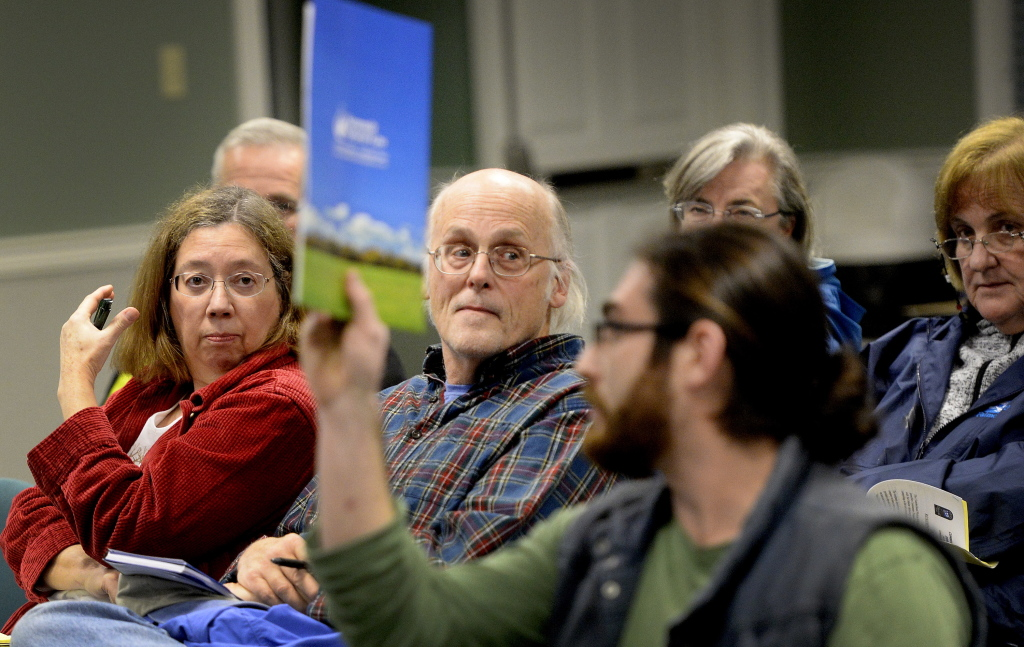 Charlotte and James Hurd of Cumberland listen to comments during Monday night's Town Council meeting, where residents shared their stories about Dave Ireland Builders. Ireland took deposits of thousands of dollars for heating systems in Cumberland, Yarmouth and Falmouth that he apparently will never install.