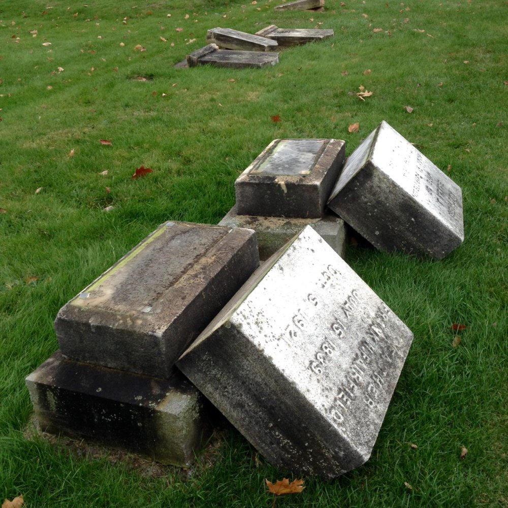 Vandals topped dozens of headstones at Riverside Cemetery in Augusta sometime Tuesday night or Wednesday morning, damaging some of them.