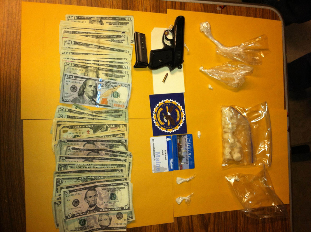 Police display items confiscated in a search of an apartment on Summer Street in Biddeford on Tuesday.