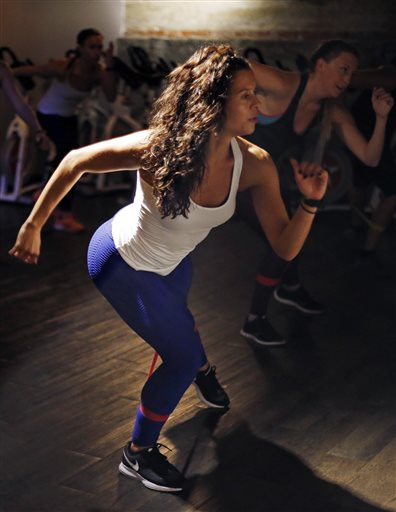 """Kelly Brabants leads her """"Booty by Brabants"""" class at The Club by George Foreman III gym in Boston. The Associated Press"""