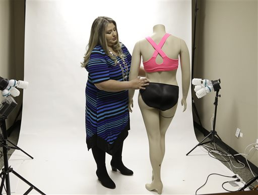 Jessica Asmar, owner of Feel Foxy, repositions a mannequin wearing a pair of padded panties in the studio at her Katy, Texas warehouse. The Associated Press