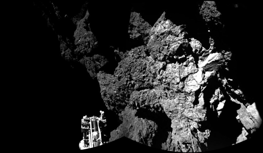 This composite image released by the European Space Agency on Thursday shows  Rosetta's lander Philae on the surface of Comet 67P/Churyumov-Gerasimenko. One of the lander's three feet can be seen in the foreground. The Associated Press.