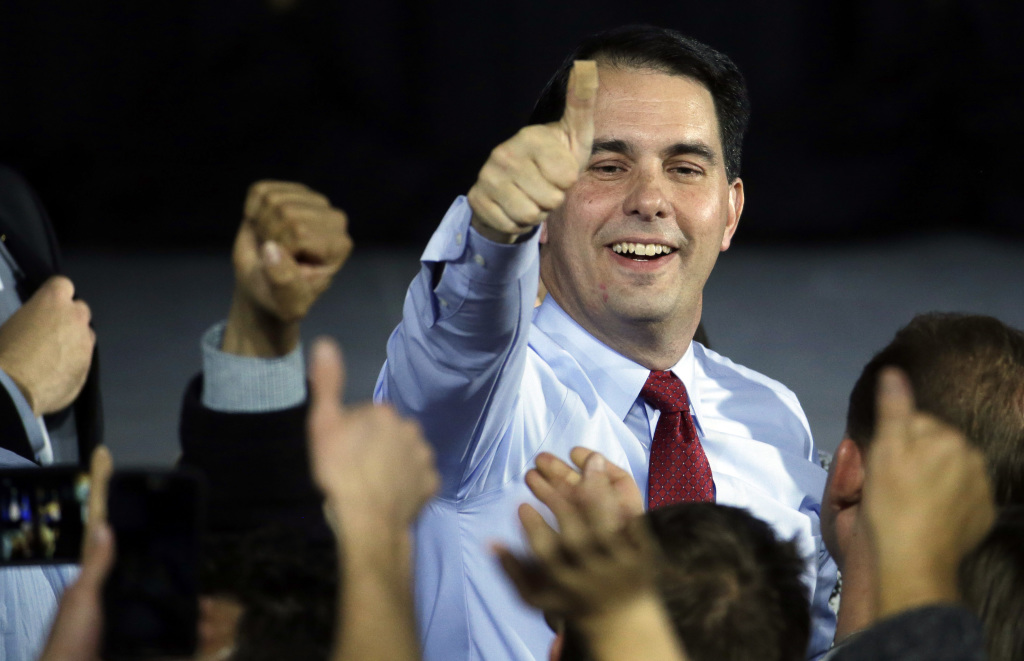 Wisconsin Republican Gov. Scott Walker greets supporters at his victory party on Tuesday in West Allis, Wis., after defeating Democratic challenger Mary Burke. The Associated Press