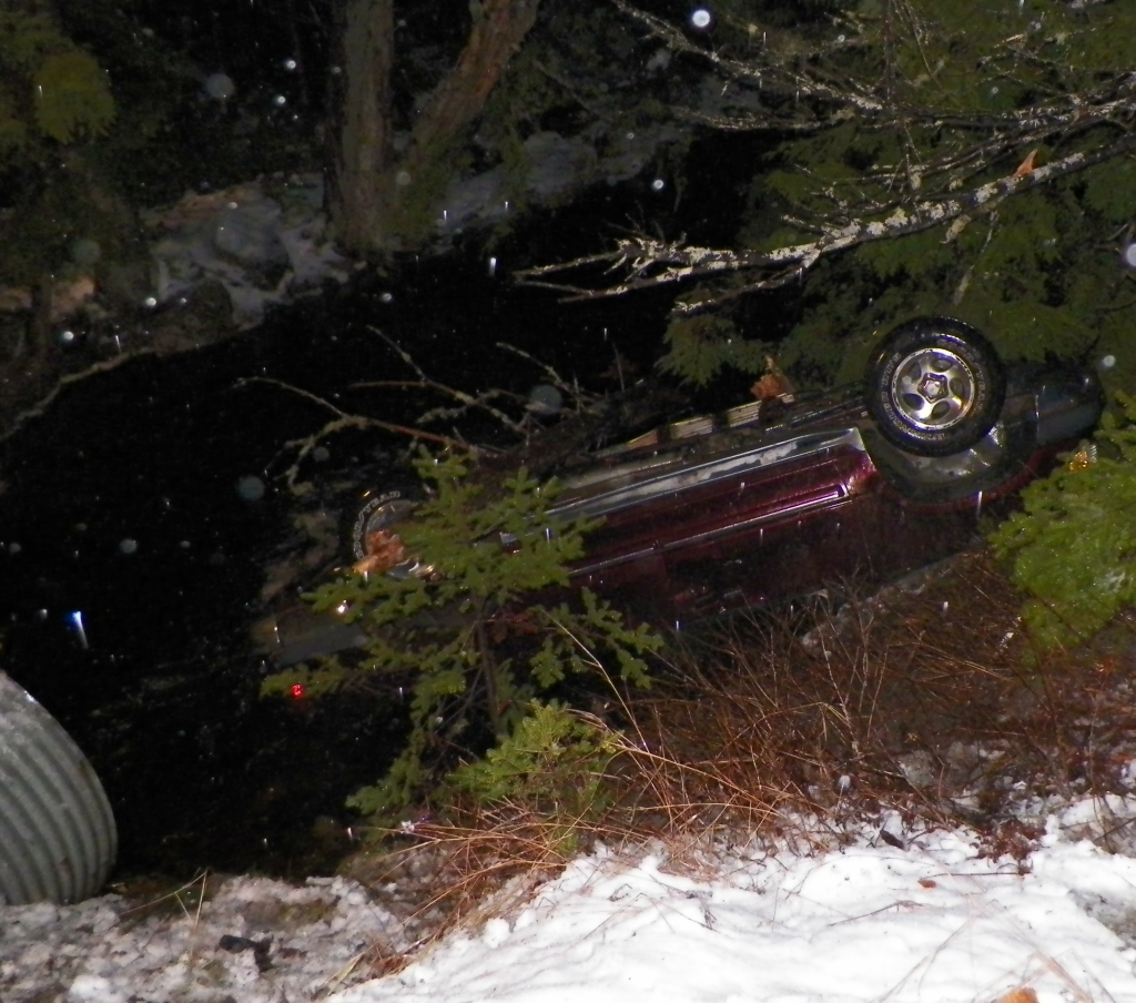 In this photo an SUV where a passerby pulled an infant trapped and submerged inside the vehicle. Photo courtesy of Maine State Police