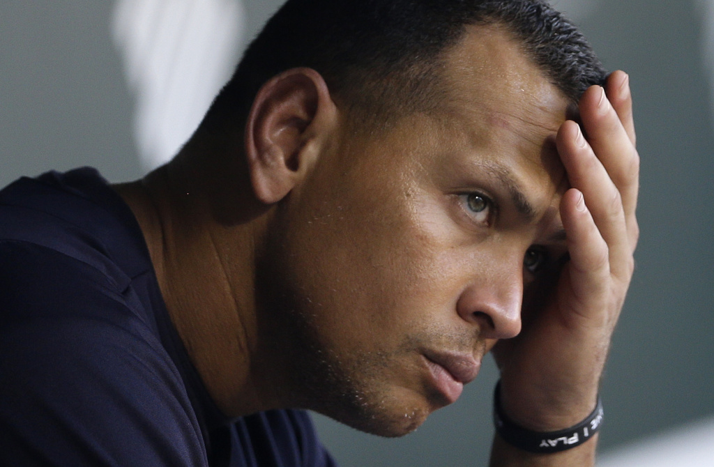 New York Yankees' Alex Rodriguez wipes sweat from his brow as he sits in the dugout before a baseball game against the Baltimore Orioles in Baltimore Sept. 11, 2013, file photo. The Associated Press
